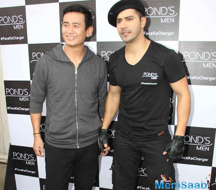 Varun And Bhaichung Pose Together Pond's Men Face Ka Charger Promotional Event