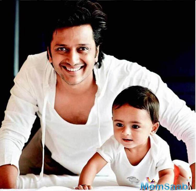 Riteish And Riaan Strikes A Same Pose On Their Bed