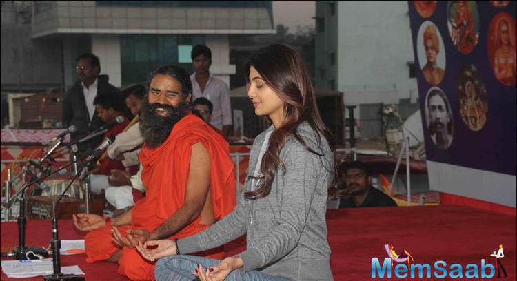 Shilpa Who Known For Her Fit Frame Presented Her Book The Great Indian Diet To Yoga Guru Ramdev