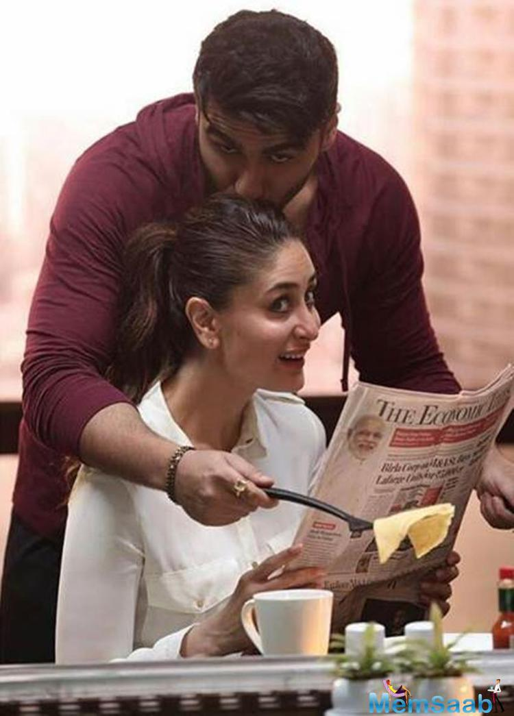 Arjun Kapoor is preparing breakfast for his dearest Working Wife Kareena Who is busy reading Newspaper