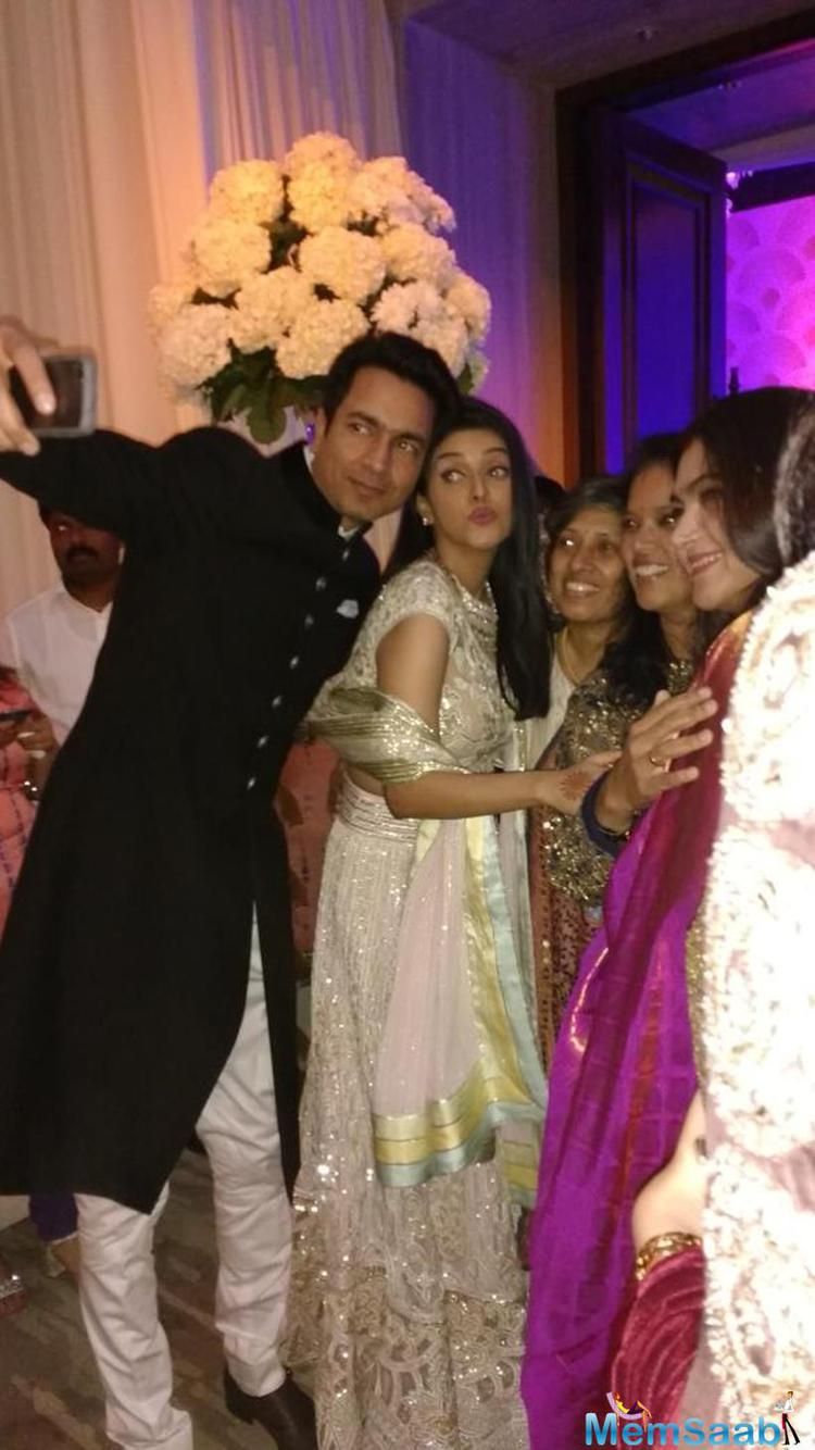 Asin Spout pose with her new partner and guest during the reception party