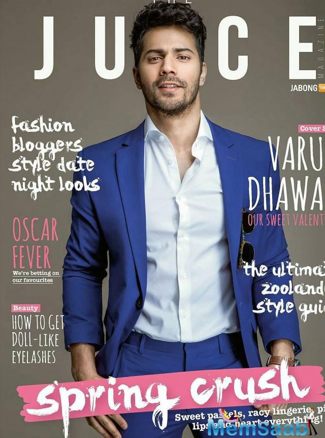 Bollywood hunk Varun unveiling the cover of February edition of The Juice magazine for Jabong