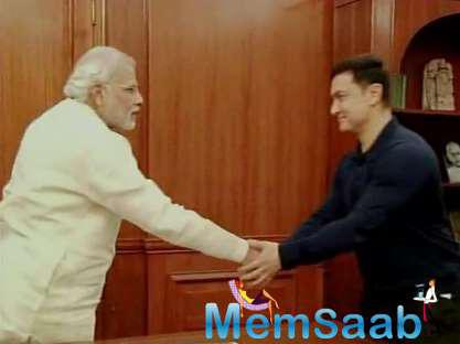 Aamir Khan was seen with a DVD set of his TV show Satyamev Jayate while he was speaking to Modi at the Prime Minister's Office