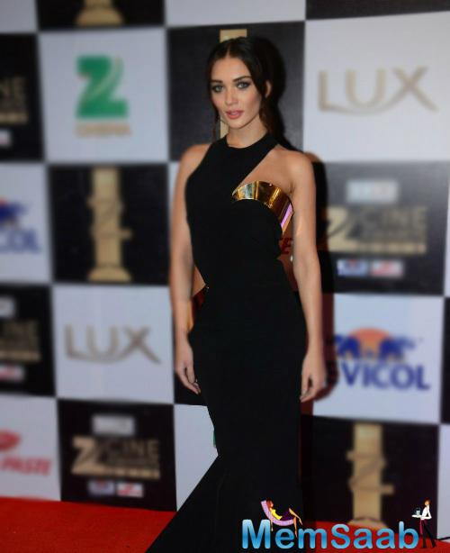 Amy Jackson grabs eyeball wearing a Monisha Jaising cut-out gown at the Awards event last evening.