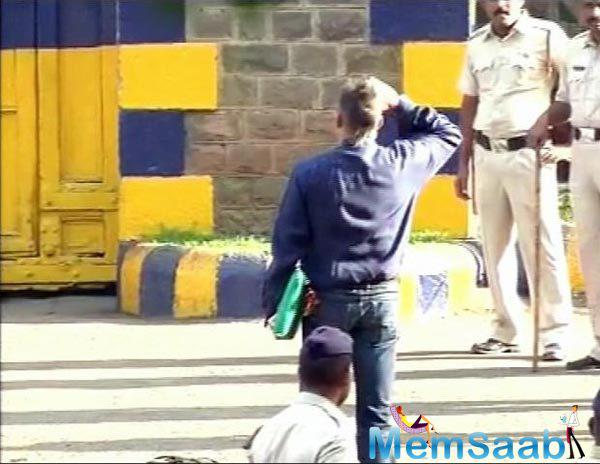 Actor Sanjay Dutt walks out of Yerwada jail after his release, and salute the National Flag.