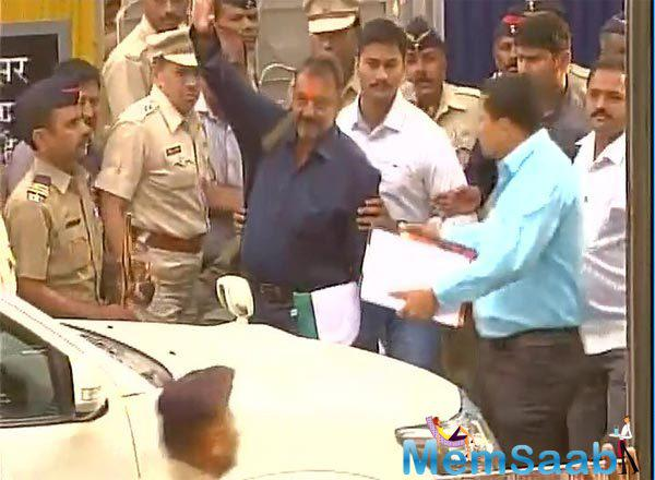 Sanjay Dutt waves his fans after release from Pune's Yerwada Central Jail