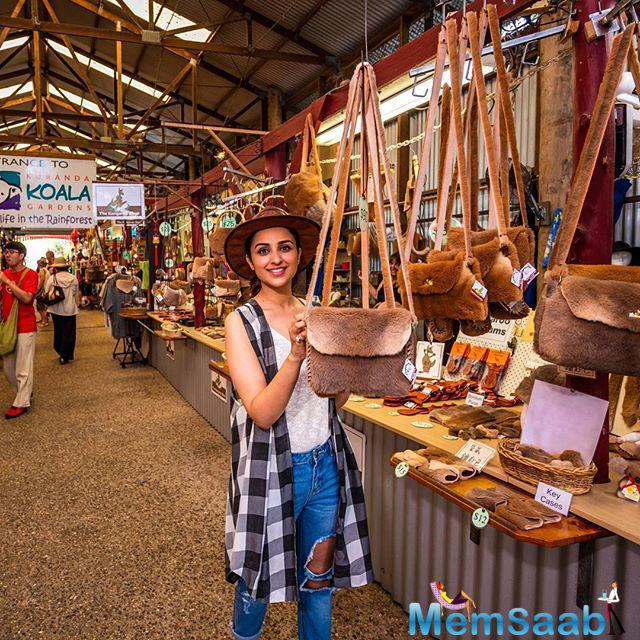 Parineeti walking around the market in a Kuranda village, A quaint town in the rain forest of tropical north queensland,  and she picked up an Australian hat.