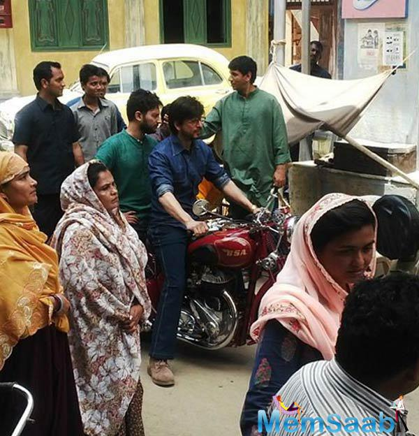 In another sequence, Shah Rukh, who plays a Gujarati don, was seen riding a maroon Royal Enfield.