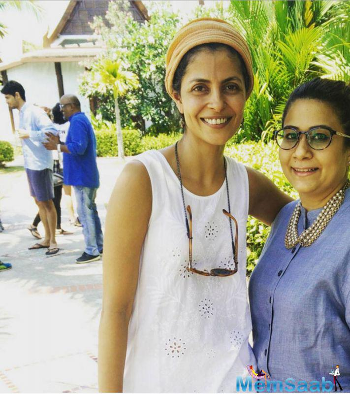 While director Nitya Mehra poses for a picture and behind her Sidharth prepare a shoot for the movie 'Baar Baar Dekho'.