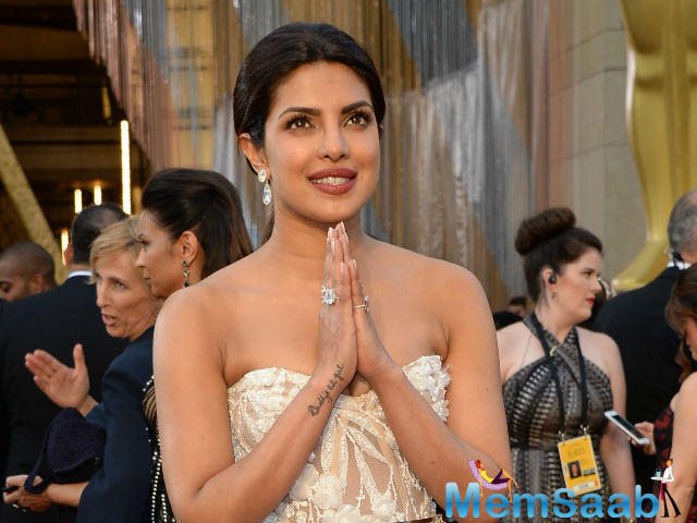 The former Miss World Priyanka pulled her hair back into a subtle pony with a center part. The 33-year-old actress also rocked a very light, golden brown smokey eye.