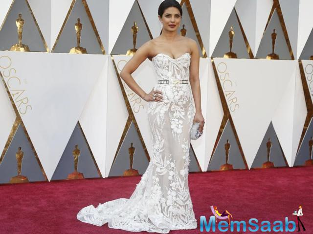 Wow, Priyanka Chopra opted for a white embellished strapless gown by Lebanese designer Zuhair Murad at her maiden Oscars where she is also presenting.