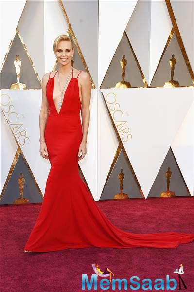 The Oscar winner Charlize Theron looks like a true movie star is eye-catching red.