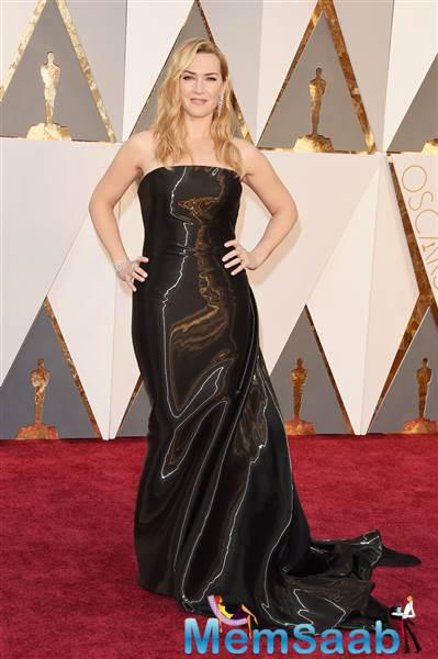 You go, Kate Winslet ! This slippery, very  shiny style stands out on the best-supporting-actress nominee.