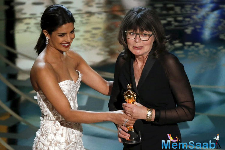 Bollywood star Priyanka Chopra hands over the Best Editing award to Margaret Sixel after she won Best Film Editing for 'Mad Max Fury Road.