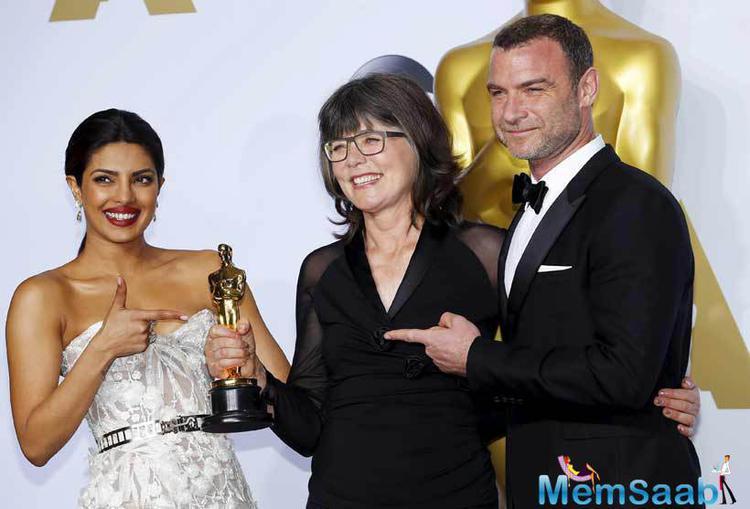Oscars awards Presenters Priyanka Chopra and Liev Schreiber walk backstage at the 88th Academy Awards.