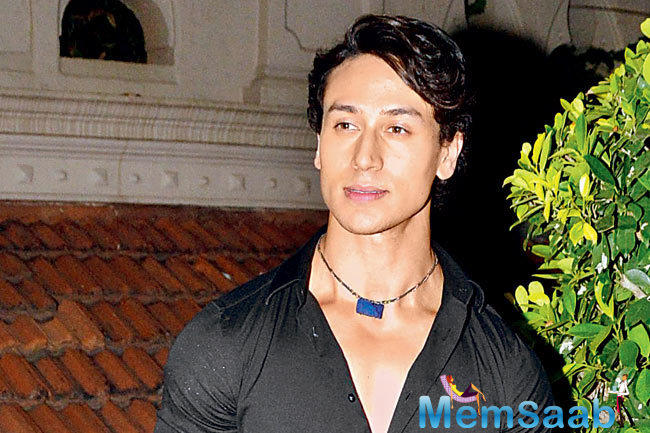 She wrote 'Presenting... MY FAVORITE REBEL! #BAAGHI HAPPY BIRTHDAY @iTIGERSHROFF.'