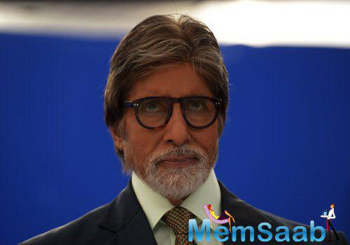 Big B has also shared an image in which he is seen wearing a pair of glasses and is all suited up.