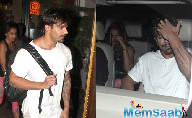 Have a look: where Bipasha, who was looking down, was trying to avoid the paparazzi, while a ring was visible in her hand.