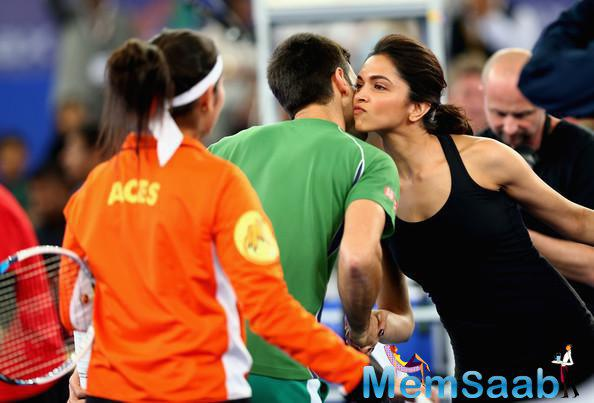 Convey look, where Deepika  kisses Novak Djokovic of the UAE Royals during the International Premier Tennis League.