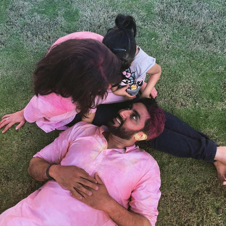 See this picture, Abhishek Bachchan shared a pic on Instagram on Friday, which shows him, resting on Aishwarya's lap with Aaradhya, all three smeared in Gulaal.