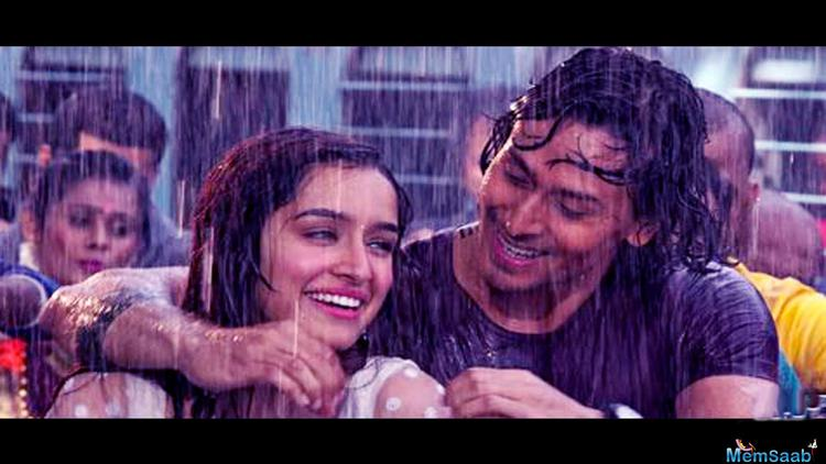 Tiger-Shraddha, love is in the rain. Here a pic from the teaser Of Song Cham Cham.