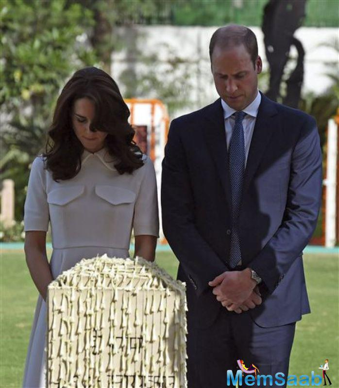 The Duke and Duchess of Cambridge, William and Kate,  bowed their heads as they stood in front of a memorial for Gandhi.