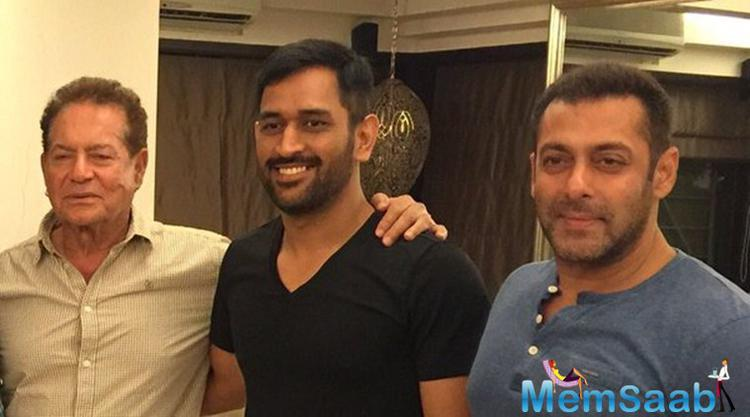 In this rare inside picture, Dhoni posed with Salman Khan and his father Salim Khan at their residence.