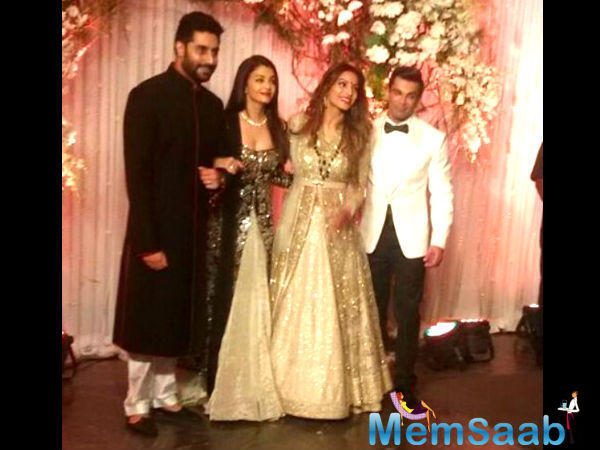 Bipasha looked elegant in a gold sequined lehenga gown, while her groom looked handsome in an ivory tuxedo.