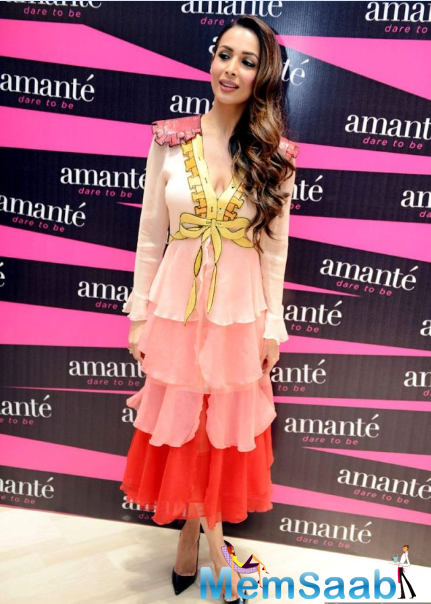 Malaika was photographed wearing Gucci.The pink and red ombre hues of Malaika's outfit took her style a notch higher.