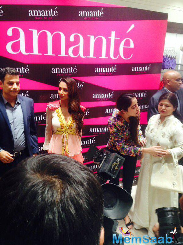 While in Noida for a store launch Malaika Arora Khan shone in a frilled Gucci dress at DLF Mall .