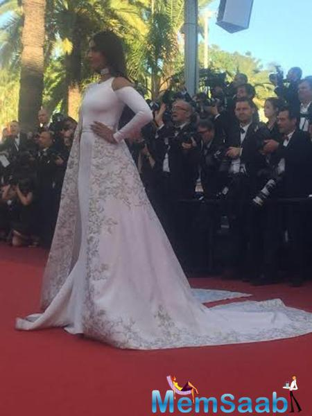 Sonam Kapoor wear a custom Ralph & Russo saree-inspired gown during walking on the red carpet at Cannes Film Festival.