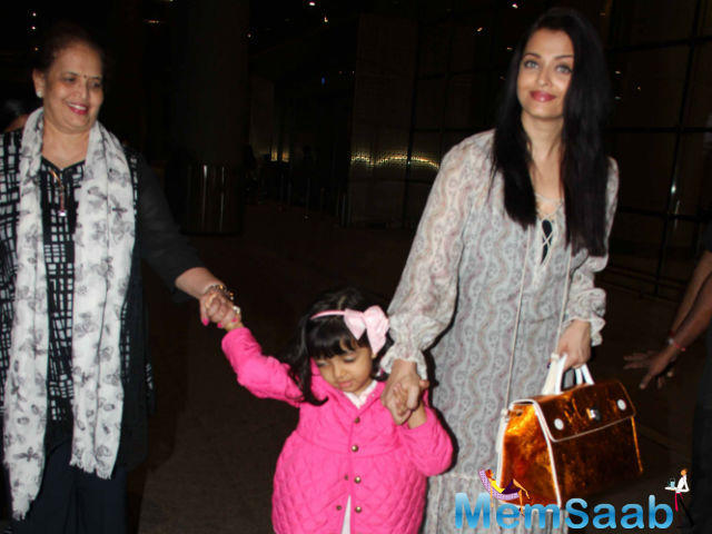 Aishwarya's all too brief Cannes visit has ended and the actress was shot at Mumbai airport on Monday. She was accompanied by her mother Brinda and daughter Aaradhya.