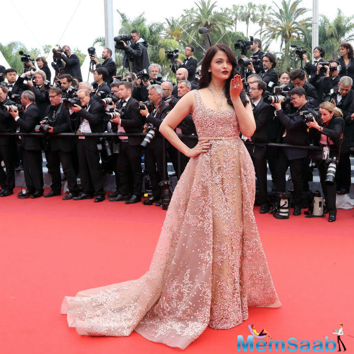 Her second red carpet dress in gold lace by Elie Saab was better received