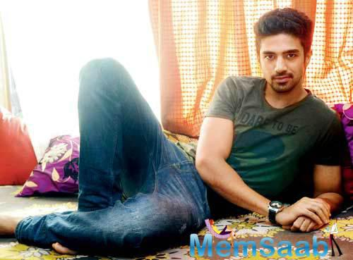 Saqib Saleem, who plays a cricketer in the movie, 'Dishoom', says that he is not playing star cricketer Virat Kohli and was not offered that role but it was his own decision to mold his character for him.