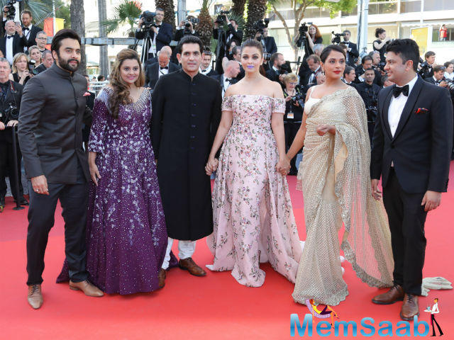 Aishwarya Rai poses with the cast of Sarabjit as she arrives on red carpet for the screening of the film Mal de Pierres (from the Land of the Moon) in competition at the 69th Cannes Film Festival in Cannes, France, May 15, 2016.