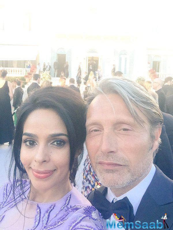 Mallika Sherawat, who is currently attending the 69th Cannes Film Festival, has shared a selfie with Hollywood star Mads Mikkelsen, who was also in the French Riviera for the film gala.