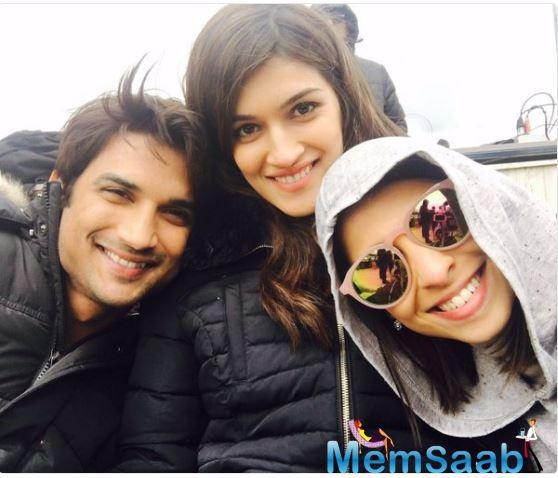 """Kriti Sanon took to her Twitter handle and posted a selfie with Sushant, writing, """"Shooting for my fav song!!@itsSSR @AyeshaAhmad28 #Raabta #lovesongshoots."""""""