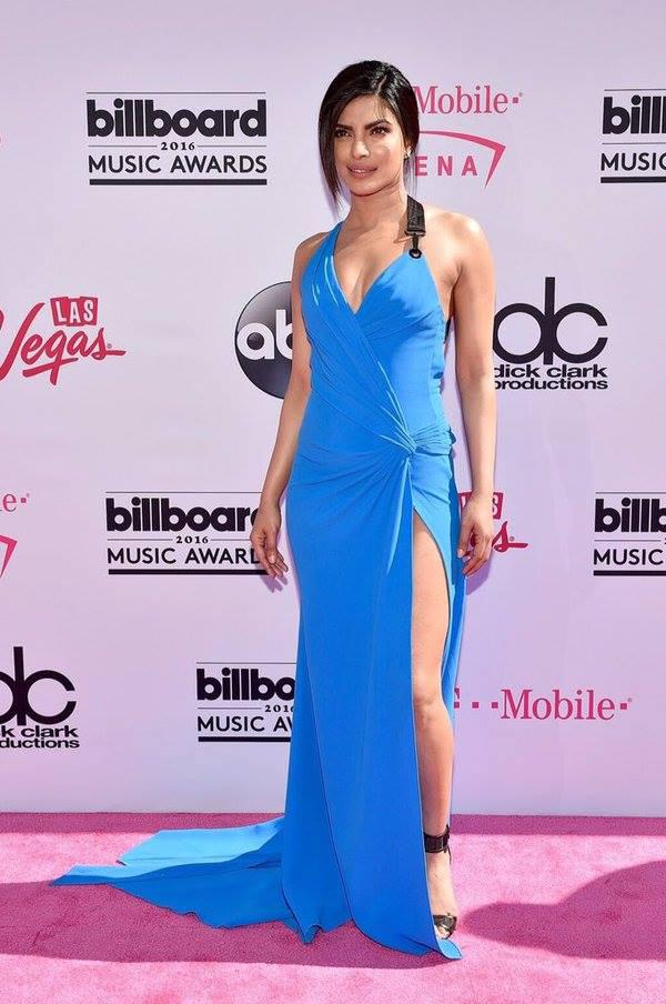Singer and Quantico actress Priyanka Chopra strikes a pose on the red carpet and dressed in a blue Versace gown