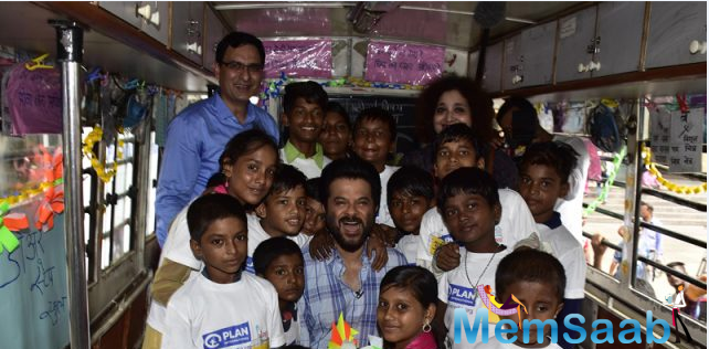 After the event Anil Kapoor met with children from Mumbai's slums who work to support their families and are therefore unable to attend regular schools.