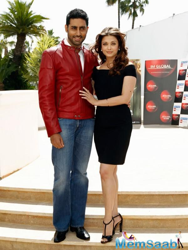 "Cutting short all talk of a public tiff with his wife at the premiere Abhishek laughs, ""We Bachchans don't fight in public"