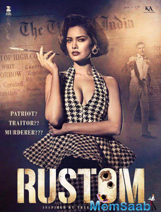 That's Priti Makhija portrayed by Esha Gupta. Priti wants Rustom to be hanged dead, as he killed her brother Vikram.