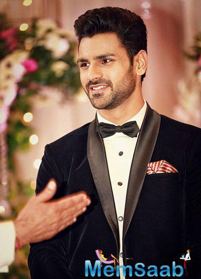 Divyanka is glowing in a maroon and golden ensemble, Vivek chose to wear a black and white tux from TISA studio.