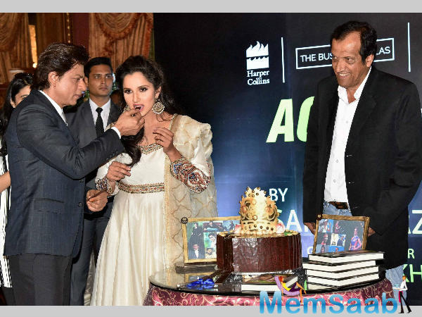 Tennis player Sania Mirza and Bollywood star SRK at the launch of Sania Mirza's autobiography, 'Ace against Odds,' in Hyderabad.