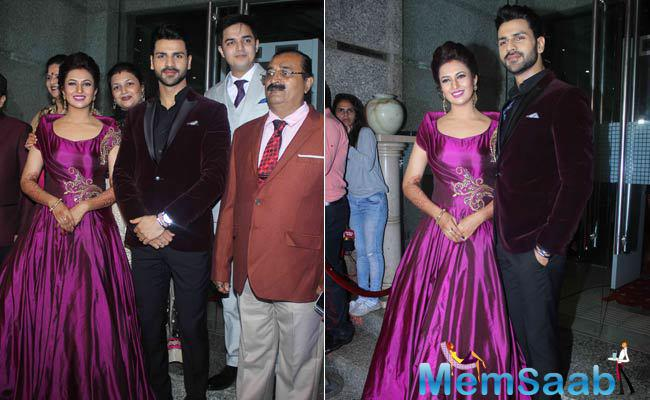 Divyanka's reception outfit was an embroidered purple gown. Vivek wore a maroon velvet jacket. The couple posed with their family members.