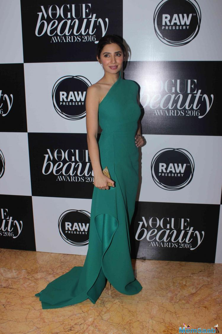 """""""It's my dream come true to work with SRK and also I am very excited about 'Raees'. But more than this, I am nervous too,"""" Mahira said on the sidelines of Vogue Beauty Awards here."""