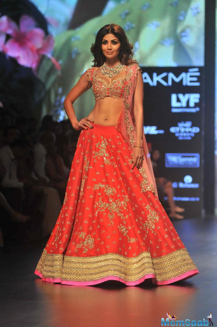 The sexy and svelte diva Shilpa Shetty looked ethereal as she walked down the ramp for The Wedding Chronicle by Anushree Reddy on the last day of the Lakme Fashion Week.