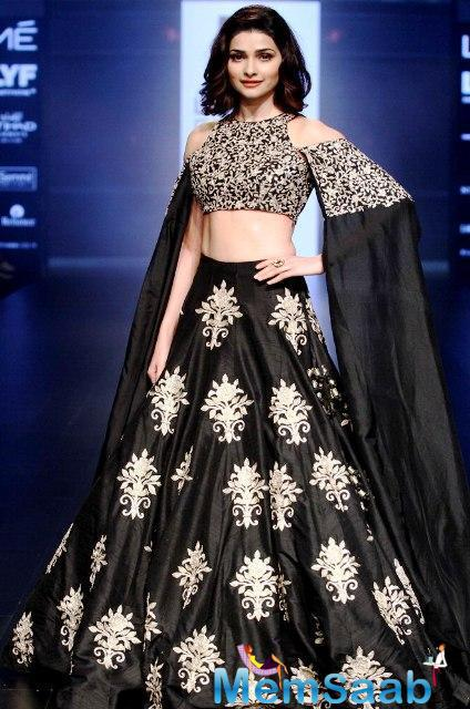 Prachi's look were the cut-outs on her choli along with the cape element which gave it a dramatic look. Her short hair and nude lips complimented the collection's metallic brocades add glamour to the garments.