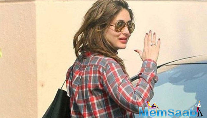 Bollywood actress Kareena Kapoor Khan, who is expecting her first baby with hubby Saif Ali Khan after the first week of December, was spotted on the streets of Mumbai in a smashing outfit.