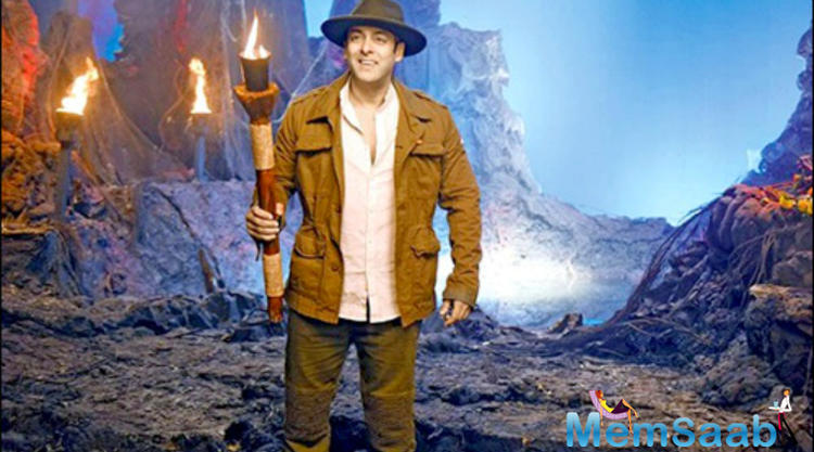 In this promo, his get-up, which is so Indiana Jones-inspired. Look this pic, where he is in a cave and throws a fire torch in his hands.