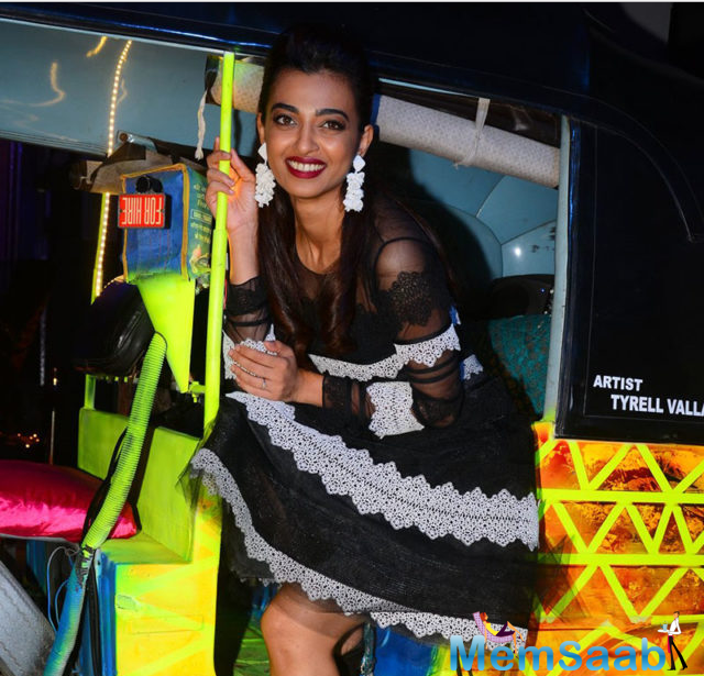 Radhika Apte went stylish in a long black dress at the event and cutely posed with an auto rickshaw at the venue. She has been getting rave reviews for her performance in Leena Yadav's 'Parched'.